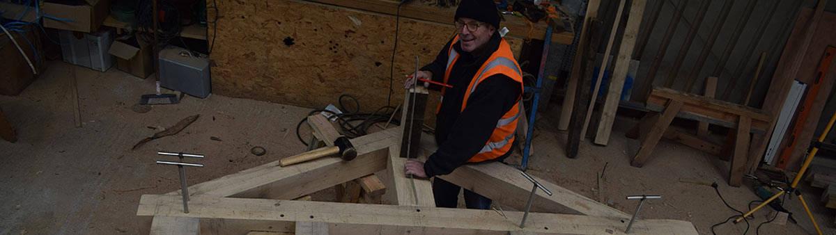 Timberpride team member building oak frame structure
