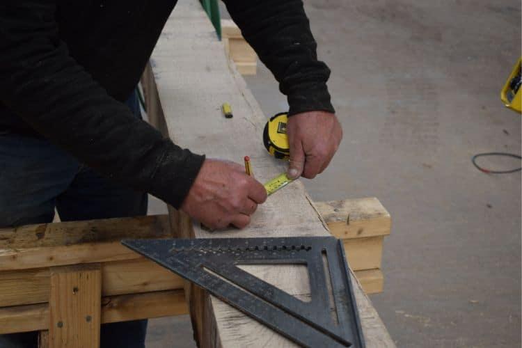 Oak being measure using traditional skills